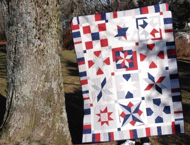 Red, blue, and grey star sampler quilt