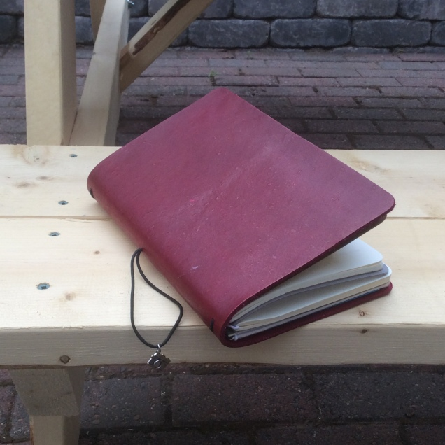 Leather fauxdori with red cover