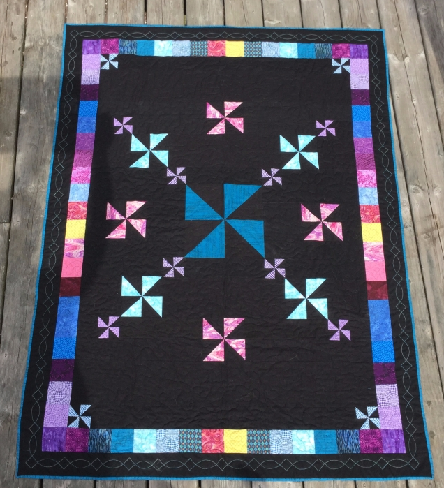 Pin wheel quilt on black background