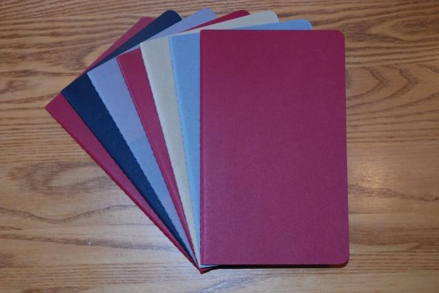 A pile of unused Moleskine large cahiers